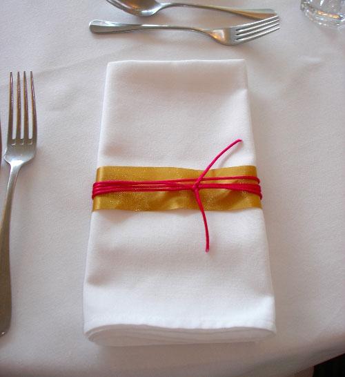 White linen napkin with ribbon detailing