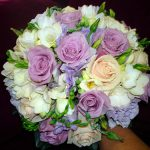 Fresh mixed flowers in mauve, cream and white