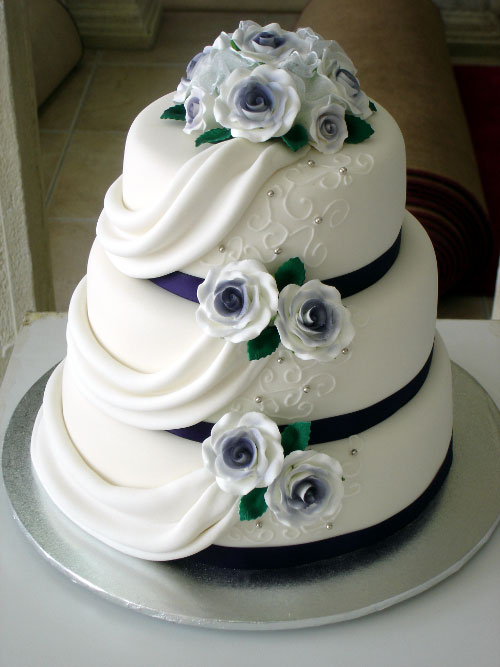 3 Tier Cake with Icing Roses and Drapes