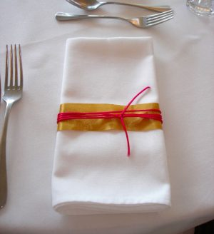White linen napkin with ribbon detailing