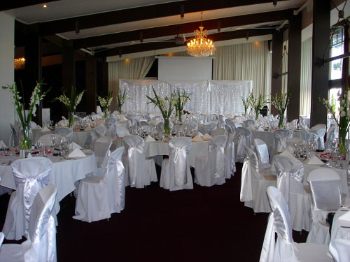 Elegant white wedding reception setting